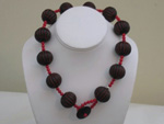 Painted wood and coral necklace with button closure